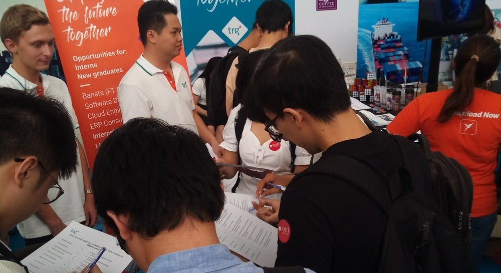 RMIT students playing games at the TRG stand